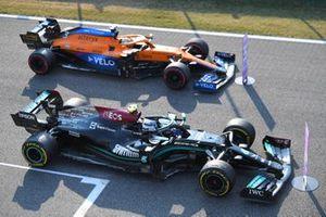 Valtteri Bottas, Mercedes W12, 1st position, and Daniel Ricciardo, McLaren MCL35M, 3rd position, park up in Parc Ferme after Sprint Qualifying