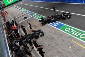 Valtteri Bottas, Mercedes W12, and Lewis Hamilton, Mercedes W12 leave the garage