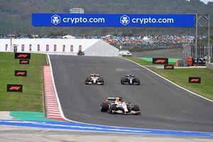 Max Verstappen, Red Bull Racing RB16B, Sergio Perez, Red Bull Racing RB16B, and Sebastian Vettel, Aston Martin AMR21