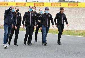 Fernando Alonso, Alpine A521 track walk with team members.