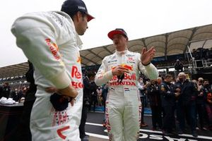 Max Verstappen, Red Bull Racing, 2nd position, and Sergio Perez, Red Bull Racing, 3rd position, talk in Parc Ferme