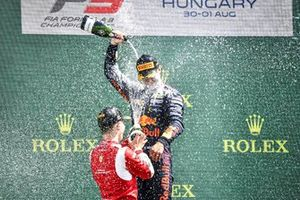 Arthur Leclerc, Prema Racing and Race Winner Dennis Hauger, Prema Racing celebrate on the podium with the chamapgne