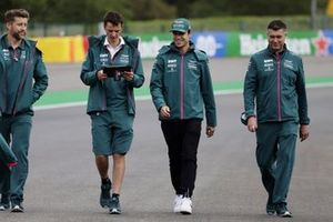Lance Stroll, Aston Martin, walks the track with members of his team
