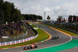 Max Verstappen, Red Bull Racing RB16B, Valtteri Bottas, Mercedes W12, and Nikita Mazepin, Haas, VF-21