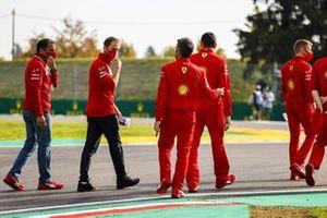 Sebastian Vettel, Ferrari, walks the track with Ferrari team mates