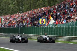 Kimi Raikkonen, McLaren Mercedes MP4/19B overtakes David Coulthard, McLaren Mercedes MP4/19B