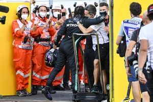 Lewis Hamilton, Mercedes-AMG F1, 1st position, celebrates with his team as marshals applaud his performance in Parc Ferme