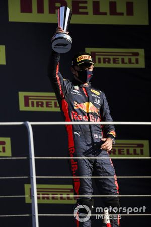 Alex Albon, Red Bull Racing, 3rd position, on the podium with his trophy