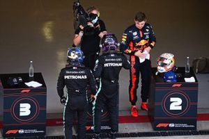 Lewis Hamilton, Mercedes-AMG F1, 3rd position, Max Verstappen, Red Bull Racing, 2nd position, and Valtteri Bottas, Mercedes-AMG F1, 1st position, in Parc Ferme