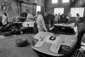 Jacky Ickx, Jackie Oliver's and David Hobbs, Mike Hailwood's Ford GT40s are worked on in the garage