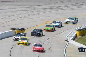 Denny Hamlin, Joe Gibbs Racing, Toyota Supra SportClips leads Brandon Jones, Joe Gibbs Racing, Toyota Supra 03 Dash Championship and the field into the pits