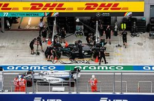 Valtteri Bottas, Mercedes F1 W11, in the pits as Nicholas Latifi, Williams FW43, passes