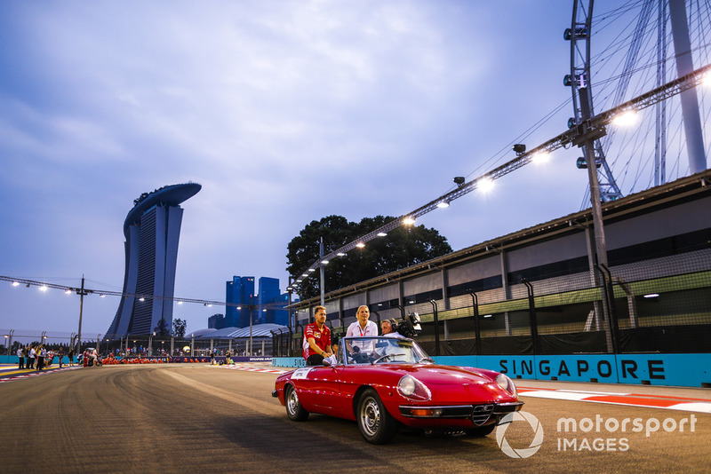 Sebastian Vettel, Ferrari, is filmed in an Alfa Romeo Spyder on the drivers' parade