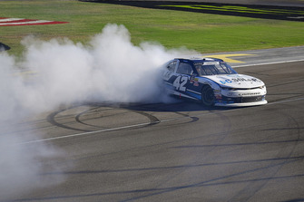 Ross Chastain, Chip Ganassi Racing, Chevrolet Camaro DC Solar celebrates with a burnout after winning