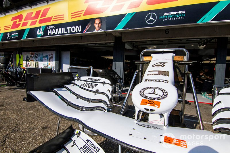 Front wing of Mercedes AMG F1 W10 with special 125th year in motorsport livery infront of the Mercedes garage
