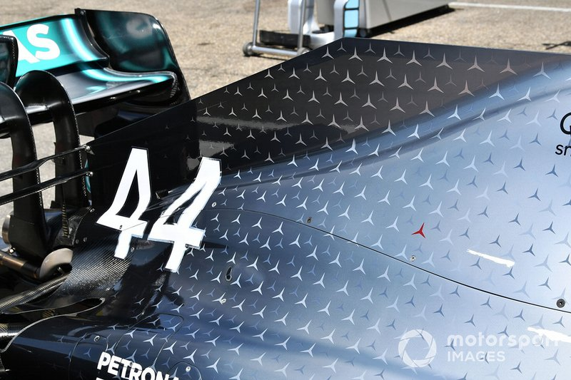 Mercedes AMG F1 W10 with special 125th year in motorsport livery with Niki Lauda Red 3 pointed star
