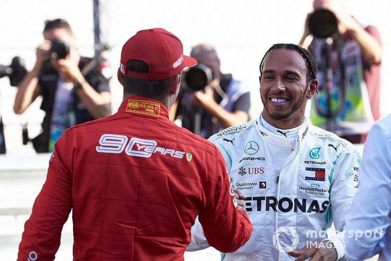 Lewis Hamilton, Mercedes AMG F1, congratulates Charles Leclerc, Ferrari, on pole