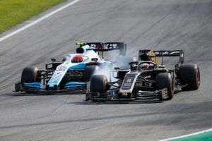 Romain Grosjean, Haas F1 Team VF-19, battles with Robert Kubica, Williams FW42