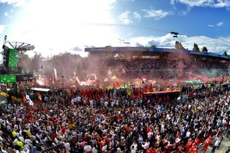 Fans pack around the podium to celebrate a home win for Ferrari