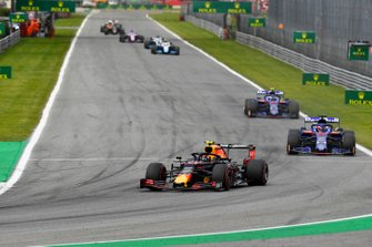 Alex Albon, Red Bull RB15, leads Daniil Kvyat, Toro Rosso STR14, and Pierre Gasly, Toro Rosso STR14