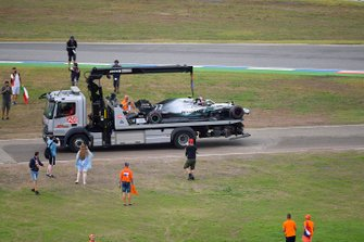 Fans invade the circuit after the race as marshals remove the car of Valtteri Bottas, Mercedes AMG W10