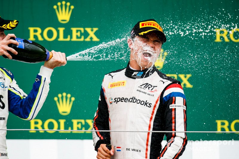 Nyck De Vries, ART Grand Prix celebrates on the podium with the champagne
