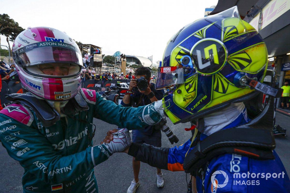 Sebastian Vettel, Aston Martin, 2nd place, is congratulated by Lando Norris, McLaren, at the Parc Ferme