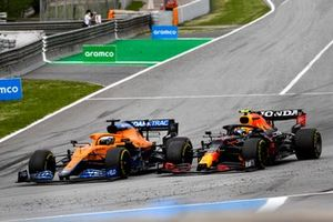 Daniel Ricciardo, McLaren MCL35M, battles with Sergio Perez, Red Bull Racing RB16B