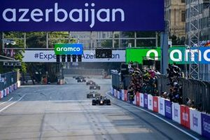 Sergio Perez, Red Bull Racing RB16B, 1st position, takes the chequered flag