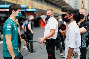 Lance Stroll, Aston Martin, talks to the press