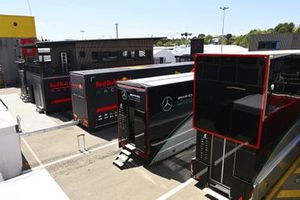 Red Bull and Mercedes truck in the paddock