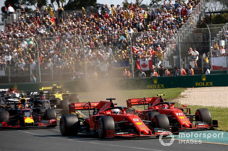 Sebastian Vettel, Ferrari SF90, leads Charles Leclerc, Ferrari SF90, Max Verstappen, Red Bull Racing RB15, Nico Hulkenberg, Renault F1 Team R.S. 19, and the rest of the field at the start