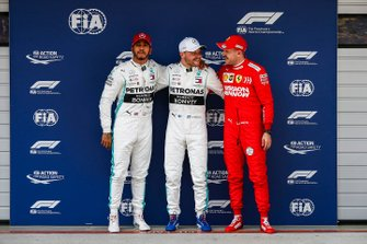 Top three Qualifiers Lewis Hamilton, Mercedes AMG F1, pole starter Valtteri Bottas, Mercedes AMG F1, and Sebastian Vettel, Ferrari