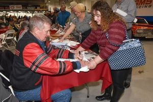 Larry Caudill signs autograph for fan