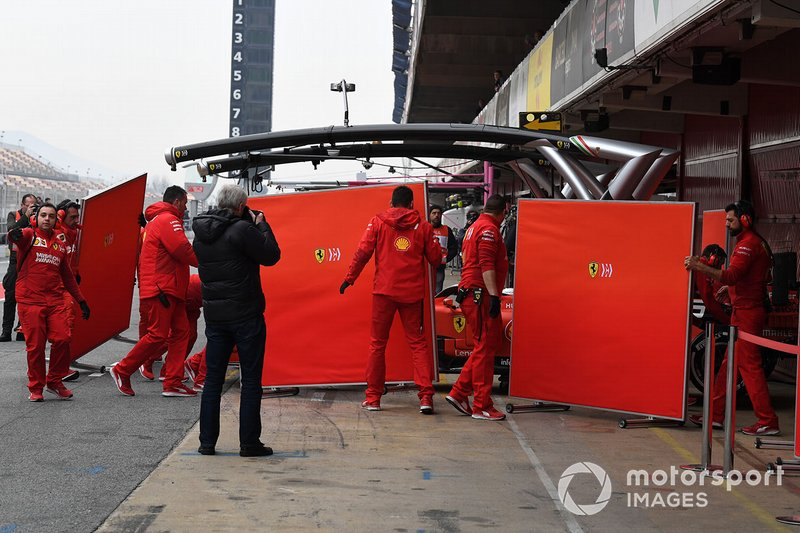 Sebastian Vettel, Ferrari SF90 and Ferrari mechanics with screens