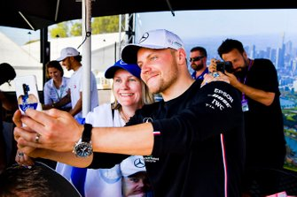 Valtteri Bottas, Mercedes AMG F1 poses for a selfie with a fan