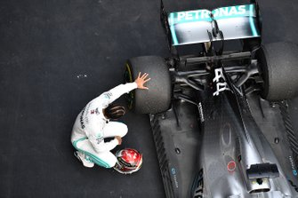 Lewis Hamilton, Mercedes AMG F1, 1st position, inspects his car after the race