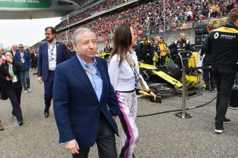 Jean Todt, President, FIA, on the grid with his wife, actress Michelle Yeoh
