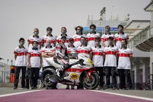 Cal Crutchlow, Yamaha Factory Racing MotoGP Test Team rider with the Yamaha YZR-M1, 60th Grand Prix Racing Anniversary livery and the team members