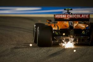 Sparks fly from the rear of Lando Norris, McLaren MCL35