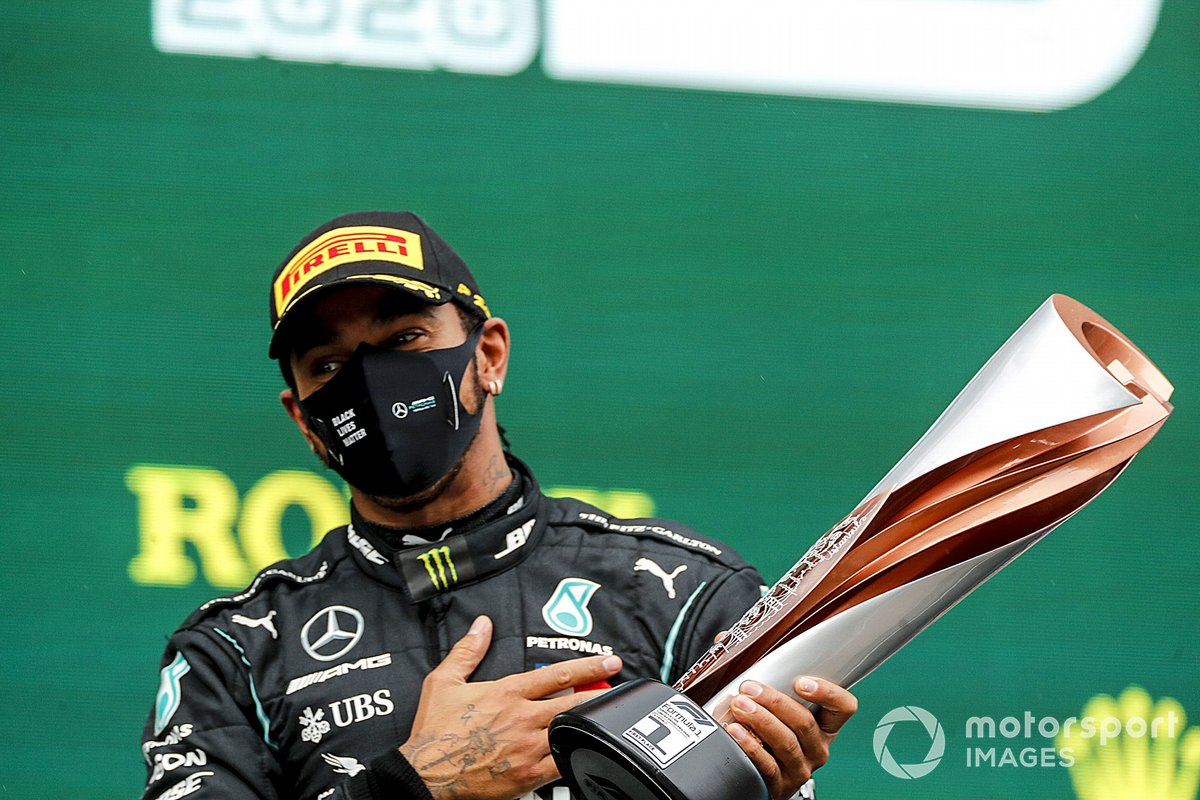 Lewis Hamilton, Mercedes-AMG F1, on the podium after winning the race, to take his 7th World Championship title