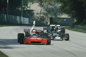 Derek Bell, Tecno PA123, Carlos Pace, March 711 Ford, and John Surtees, Surtees TS14 Ford, in practice