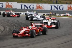 Felipe Massa, Ferrari F2008, leads Lewis Hamilton, McLaren MP4-23 Mercedes, and Robert Kubica, BMW Sauber F1.08