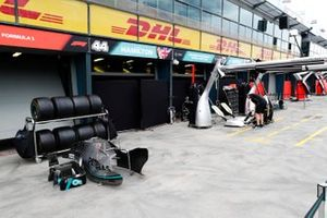 The Mercedes team start to pack up in the pit lane