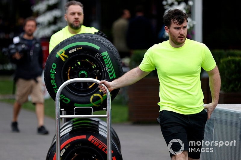 Pirelli personnel move tyres in the paddock