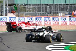Kevin Magnussen, Haas VF-20, passes as Kimi Raikkonen, Alfa Romeo Racing C39, rejoins