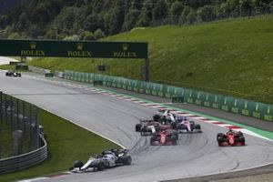 Daniil Kvyat, AlphaTauri AT01, leads as Charles Leclerc, Ferrari SF1000, and Sebastian Vettel, Ferrari SF1000, collide on the opening lap