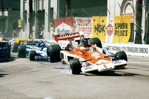 James Hunt, McLaren M23 flies into the air as he collides with John Watson, Brabham BT45B at the start of the race