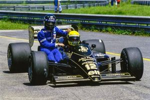 Ayrton Senna, Lotus 97T Renault, givies Jacques Laffite, Ligier-Renault a lift back to the pits