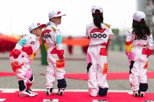 Grid kid dressed in 1000th GP kit